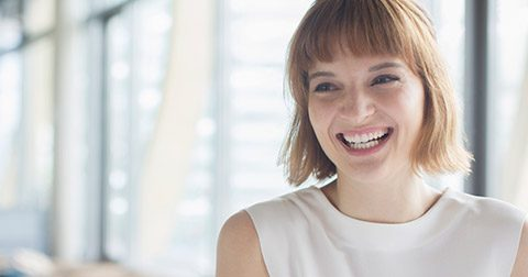 Smiling professional woman in sunny office