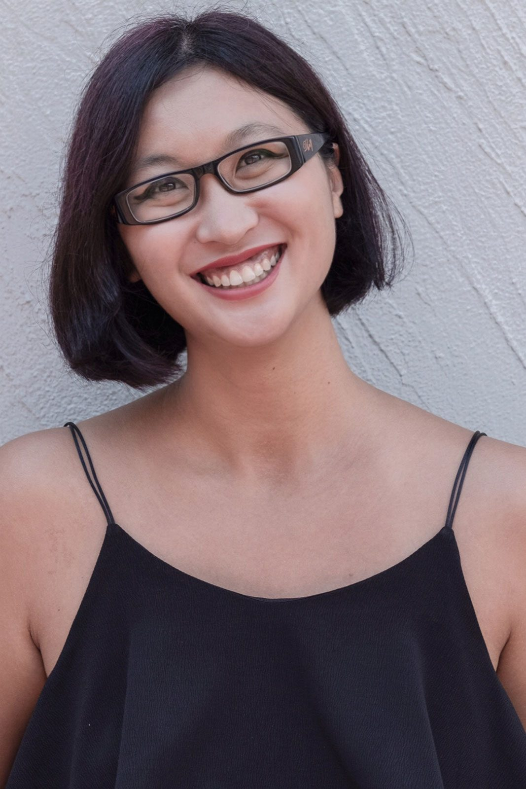 Young woman with glasses smiling