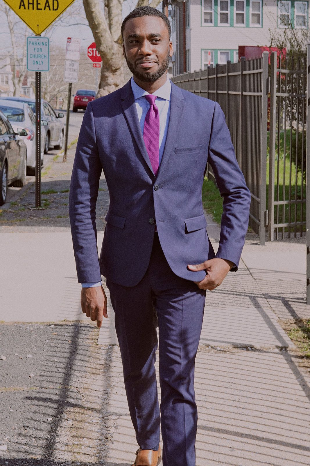18. Professional man in suit walking outside and smiling