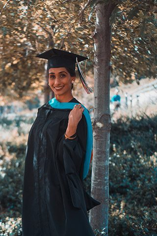 Young university graduate in her graduation gown