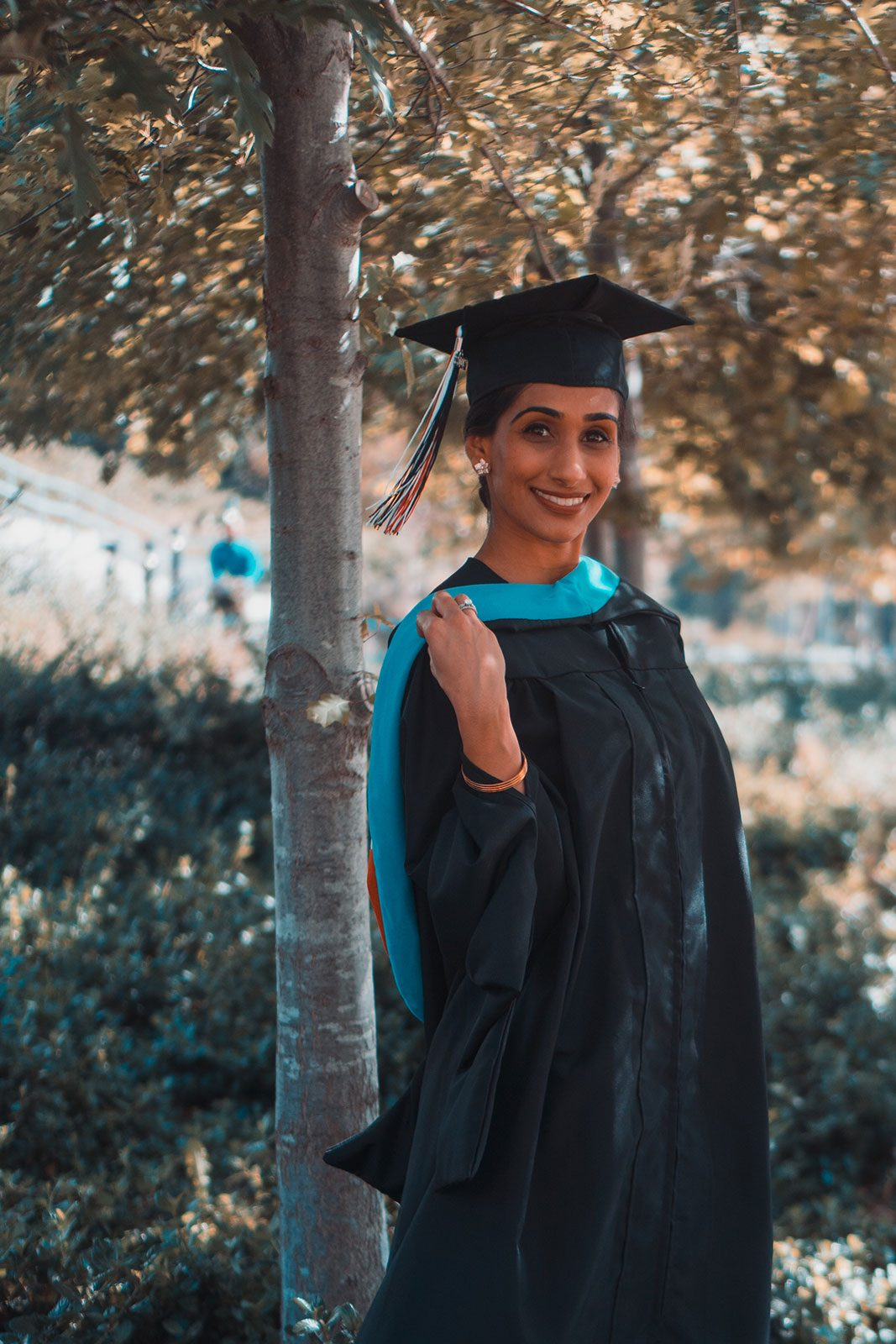 Woman on a sunny day in graduation gown