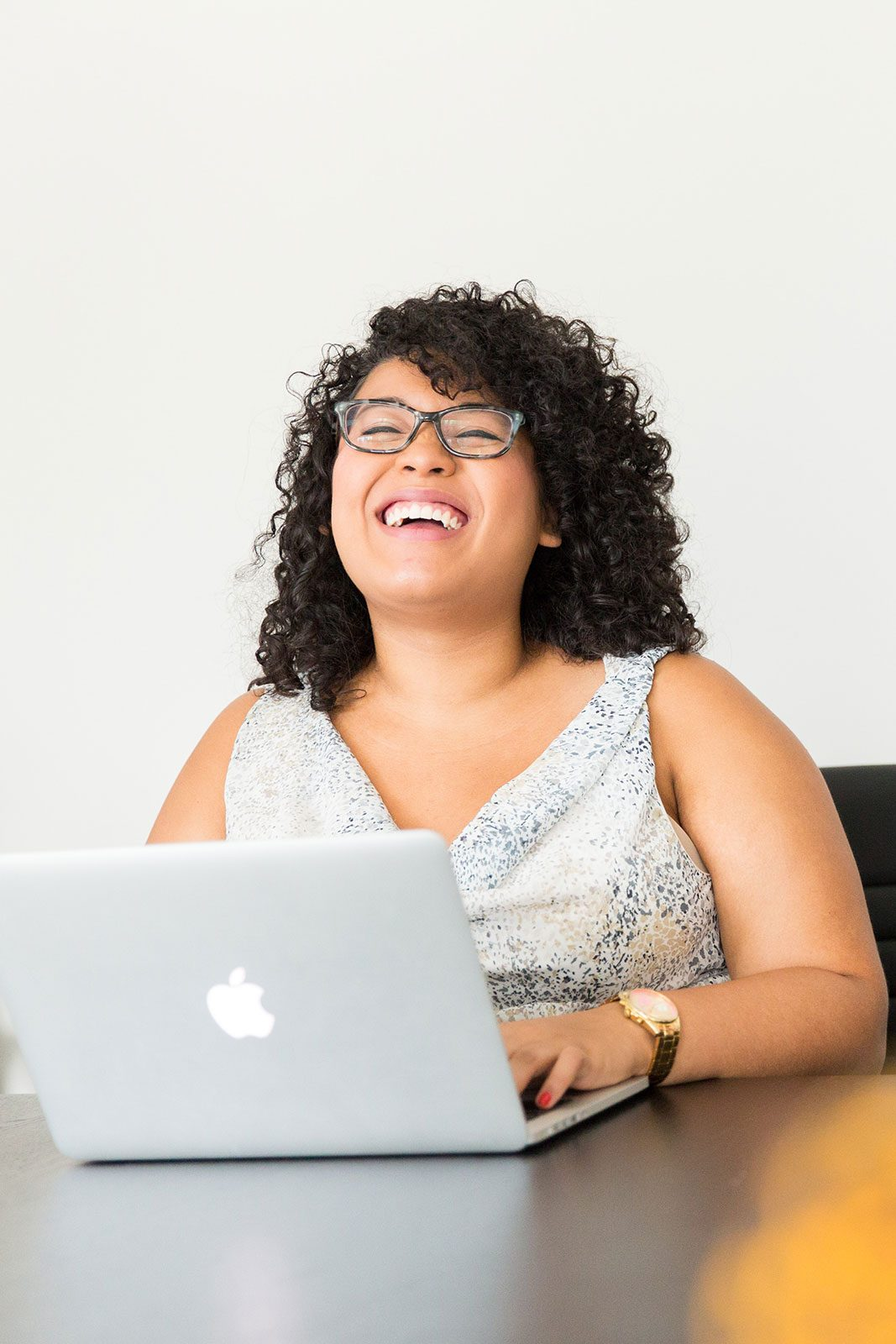 Professional woman in a office laughing