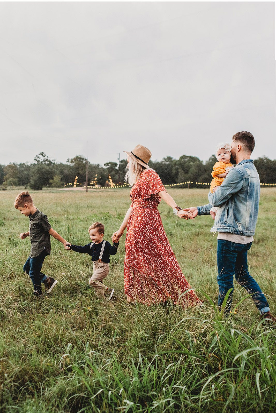 Man with his family walking through the country-side